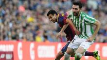 Jordi Figueras vies with Barcelona forward Pedro while playing for Real Betis.