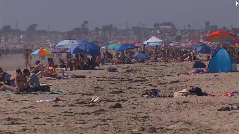 Beach crowds lead California to increase enforcement of coronavirus public health restrictions