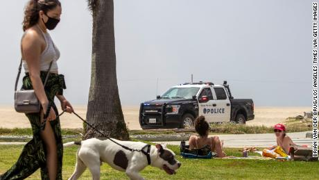 Beach crowds lead California to increase enforcement of coronavirus public health restrictions