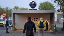 Employees walk towards an entrance gate at the Volkswagen plant in Wolfsburg, Germany, on April 27, 2020.