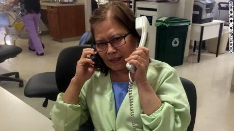 "Jhulan Banago says this photo of his mom, Celia Yap-Banago, always makes him laugh. ""I think it encompasses mom -- hardworking and joking. No one answers two phones and has two conversations at once. ... It's nice to see that mom was so happy at work."""