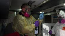 """Incorvaia prepares medication during a field intubation he calls """"the most high-risk procedure we can do in this job."""""""