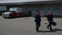 Storzillo and Incorvaia head back to their truck after bringing a probable Covid-19 patient to the ER.