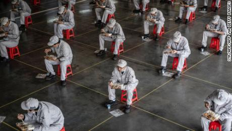 Employees on a lunch break at an auto plant of Dongfeng Honda in Wuhan, China on March 23.