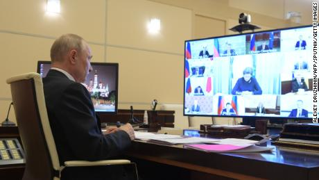 Russian President Vladimir Putin chairs a video conference meeting with heads of Russia's regions over the coronavirus situation on Tuesday.