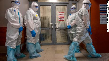 Medical workers wait to enter the red zone to treat coronavirus patients at the Spasokukotsky clinical hospital in Moscow on April 22.