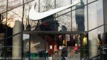 A pedestrian walking by a Nike store in Shanghai in March.