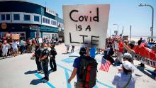 A protester claims Covid-19 is a lie. But it's killed more people than the flu this year.