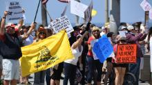 Large crowds in Huntington Beach protest beach closures by California governor