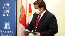 Florida governor claims coronavirus victory, but luck may have been a factor