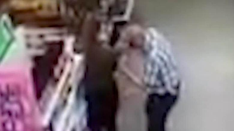 Man arrested after video shows him wiping nose on store clerk's shirt