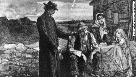 An Irish priest visits a farming family during the Great Famine.