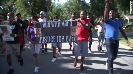 "Protesters chant, ""I run with Maud"" Tuesday in the Satilla Shores, where Arbery was killed."