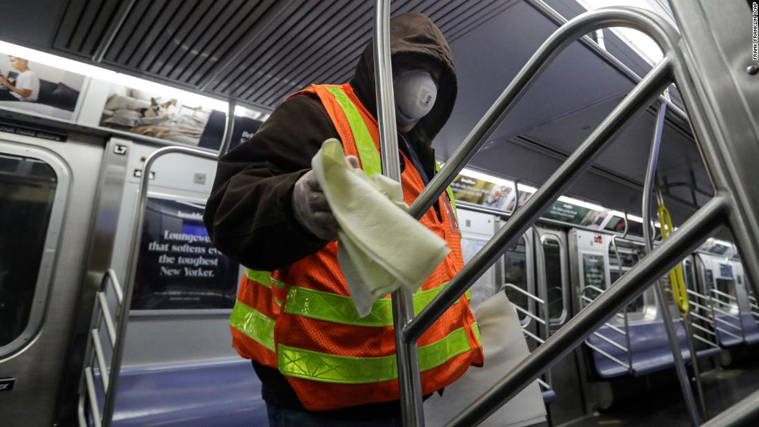 A worker helps disinfect a subway train in New York on May 6. The subway syatem was shut down for a deep-cleaning.