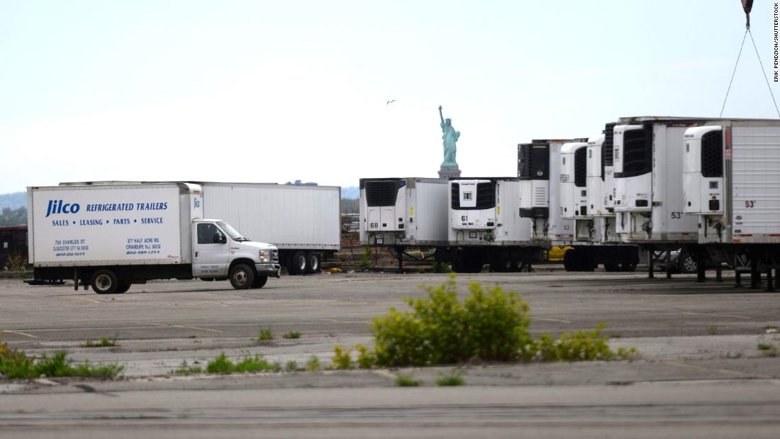 Refrigerated trucks are seen at a morgue that opened in New York to assist overwhelmed funeral homes.