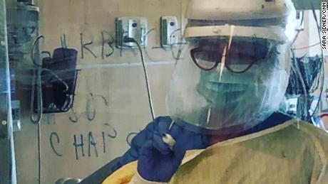 EvergrenHealth nurse writes on window what patient needs including chapstick