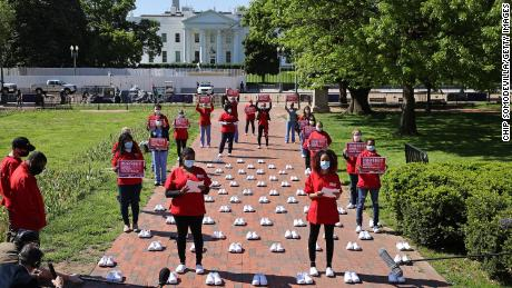 National Nurses United members held a vigil in front of the White House in May, then surrounded by 88 pairs of shoes for 88 nurses who'd died from coronavirus.