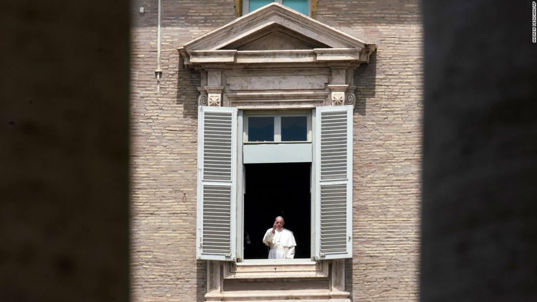 Pope Francis delivers a blessing from the window of his studio overlooking an empty St. Peter's Square on May 10.