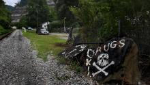 An ominous sign painted on rocks in rural Logan County, West Virginia, speaks to rural Appalachia's addiction crisis.