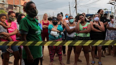 While the wealthy self-isolate, the poor can't afford to stay put in Sao Paulo