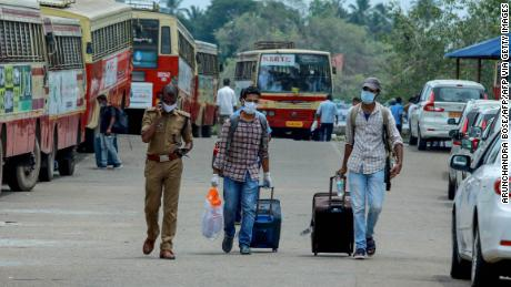 Indian citizens evacuated from Maldives arrive at the Cochin port in Kochi in the south Indian state of Kerala on May 10, 2020.
