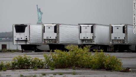 Refrigerated trucks functioning as temporary morgues in New York, which has suffered a devastating outbreak.