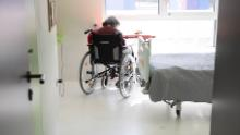 A resident sits in her room after being tested with Covid-19 in a nursing home in Bergheim, eastern France, on April 14.