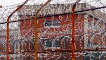 A security fence surrounds inmate housing on the Rikers Island correctional facility in New York in this 2011 photo.