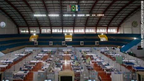 Coronavirus patients are treated at a field hospital set up at a sports gym in Santo Andre, Sao Paulo state, on May 11.