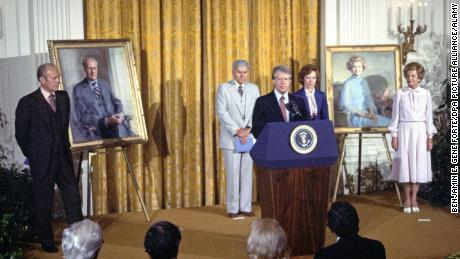 President Jimmy Carter makes remarks at the unveiling of the portraits of former President Gerald R. Ford and former first lady Betty Ford in the East Room of the White House in August 1980.