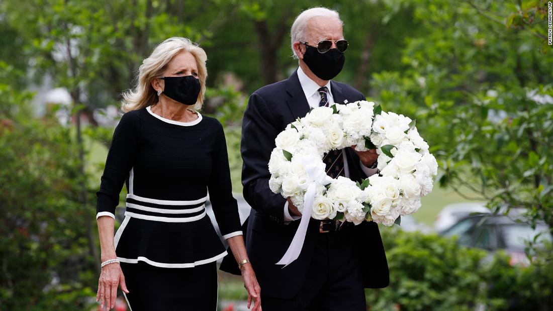 "On Memorial Day, the Bidens lay a wreath at the Veterans Memorial Park in New Castle, Delaware. <a href=""https://www.cnn.com/2020/05/26/politics/joe-biden-cnn-interview-trump-face-masks/index.html"" target=""_blank"">In a CNN interview,</a> Biden called President Donald Trump ""an absolute fool"" for sharing a tweet that mocked him for wearing a mask."