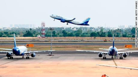 An Indigo flight directed to Varanasi takes off at the Kamaraj domestic airport during the first day of resuming of domestic flights after the government imposed a nationwide lockdown as a preventive measure against the spread of the COVID-19 coronavirus, in Chennai on May 25, 2020. - Confusion and concern reigned at Indian airports on May 25 as domestic flights tentatively resumed after two months, even as coronavirus cases continued to surge at record rates. (Photo by Arun SANKAR / AFP) (Photo by ARUN SANKAR/AFP via Getty Images)
