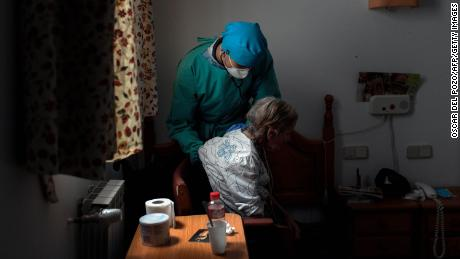 A doctor examines an isolated resident at a nursing home in Madrid, Spain on April 24.