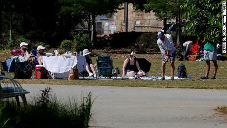 Park-goers enjoy a picnic at Historic Fourth Ward Park in Atlanta.