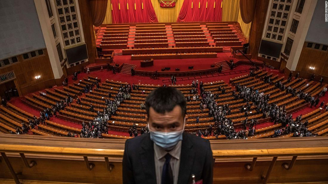 A security official stands guard at the Great Hall of the People in Beijing as delegates leave the second plenary session of the National People's Congress.