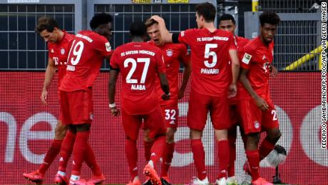 Joshua Kimmich (center) celebrates scoring against Borussia Dortmund with his teammates.