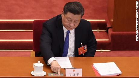 Chinese President Xi Jinping votes on a proposal on the Hong Kong security law during the closing session of the National People's Congress in Beijing on May 28.