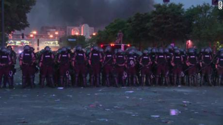 Minneapolis Police and Minnesota State Patrol form a police line.