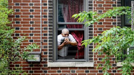 Neighbors kept their distance, paying their respect to Carlos and Lordes Coronal from their apartment windows, as the van carrying the two coffins stopped in front of the family home in Brooklyn, New York.