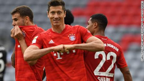 Bayern Munich's Polish forward Robert Lewandowski celebrates his opener and his side's third in the 5-0 rout of Fortuna Dusseldorf.
