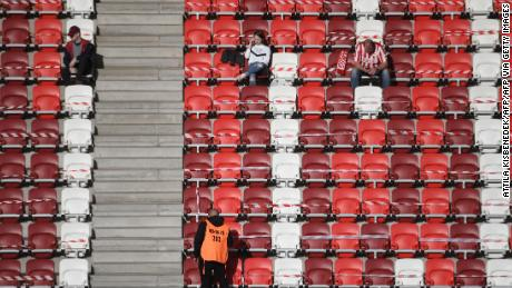 Fans of home side DVTK wait before the start of its home Hungarian league match against Mezokovesd.