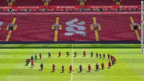 Liverpool players take a knee in memory of George Floyd.