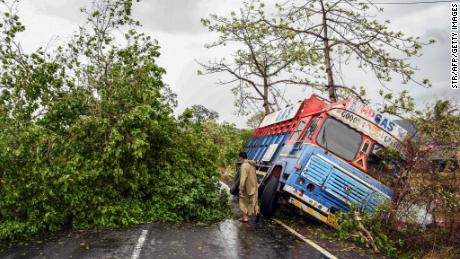 A truck is seen off the road near uprooted trees that have fallen on a main road in Alibag town of Raigad district, following Cyclone Nisarga.