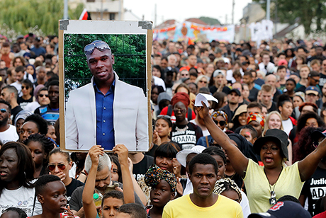 A portrait of Adama Traoré held aloft during a 2018 protest over his death two years earlier.
