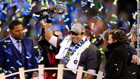 Wilson celebrates with the Vince Lombardi trophy after defeating the Denver Broncos 43-8 in Super Bowl XLVIII in 2014.