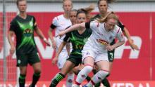 Barrett (front, r) tries to battle off Wolfsburg's Joelle Wedemeyer (l).
