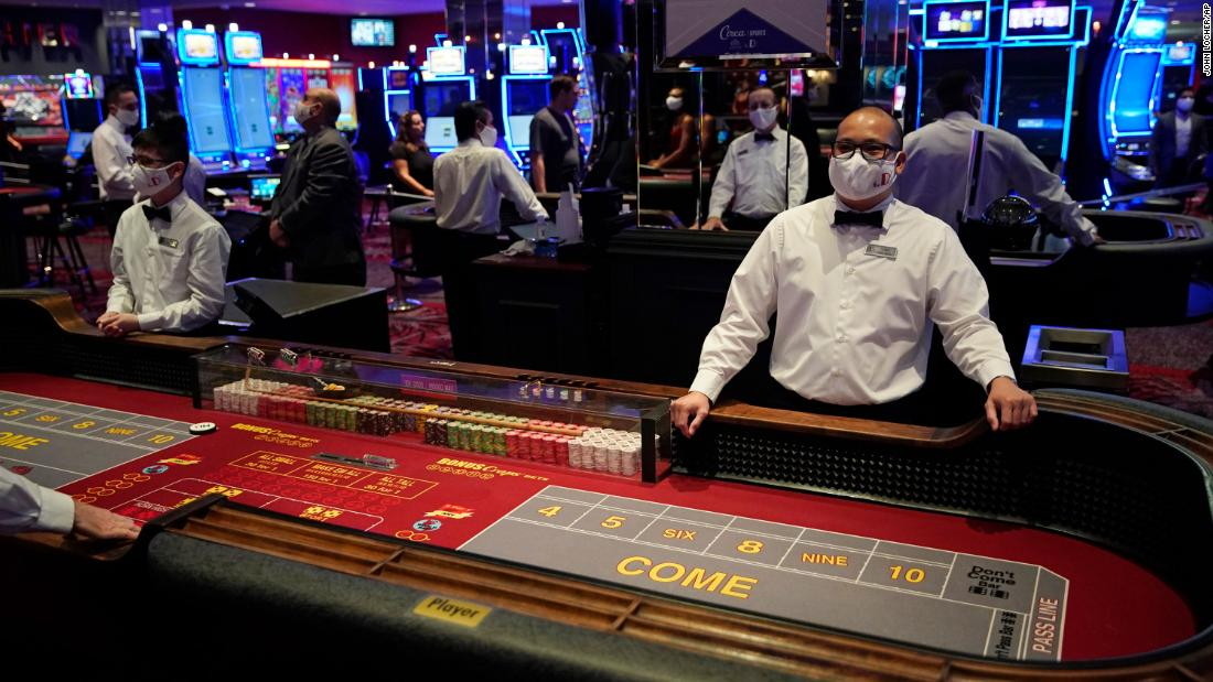 Dealers wear masks June 3 just before the reopening of the D Hotel and Casino in Las Vegas.