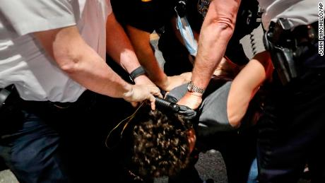 Police arrest a protester on Fifth Avenue during a march in Manhattan.