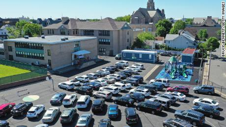 Parishioners attend Sunday morning Mass from their cars in the parking lot at the Parish of Saint Agnes Cathedral on May 31, 2020, in Rockville Centre, New York.