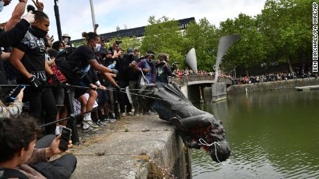 Protesters throw statue of Edward Colston into Bristol harbour during a Black Lives Matter protest rally, Sunday June 7.